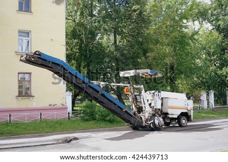 NIZHNY NOVGOROD REGION, RUSSIA - JUNE 2014: Municipal machinery for repair of asphalt covering the streets