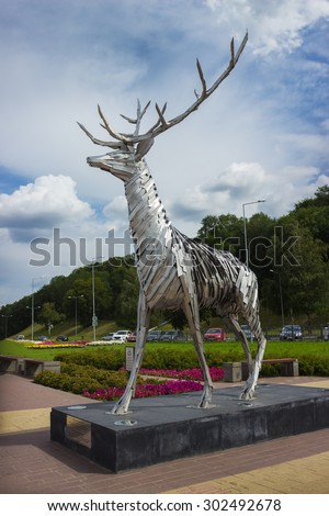 NIZHNY NOVGOROD, RUSSIA - JUL 19, 2015: Metalic sculpture of a deer. The deer is a symbol of Nizhny Novgorod - stock photo