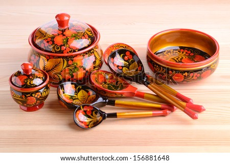 NIZHNY NOVGOROD, RUSSIA - MAY, 26, 2013: Russian Khokhloma, set from the city fair. Old wooden painting handicraft style and national ornament. First appeared in second half of 17th in Nizhny Novgorod - stock photo