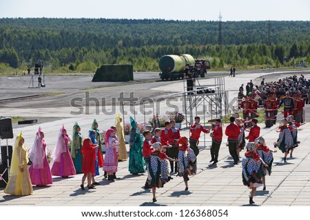 NIZHNY TAGIL, RUSSIA- AUG 22: A fancy-dress show at the opening ceremony of the exhibition RUSSIAN DEFENCE EXPO 2012 on August, 22, 2012 at Nizhny Tagil, Russia