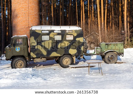 NIZHNY TAGIL, RUSSIA - FEBRUARY 08, 2015: Legendary Russian military vehicle GAZ-66 with a mobile army kitchen - stock photo