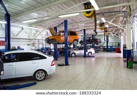 NIZHNY TAGIL. RUSSIA - JUNE 12, 2013: Cars for repair service station. Auto Service is the official dealer of Auto VAZ - stock photo