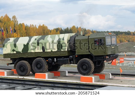 NIZHNY TAGIL, RUSSIA-SEP 26, 2013: The exhibition of armament, military equipment and ammunition RUSSIA ARMS EXPO (RAE-2013). Freight military vehicle VOLAT production MZKT - Minsk Wheel Tractor Plant