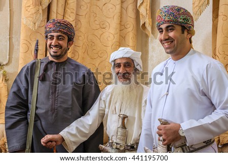 NIZWA, OMAN, MAY 27, 2016: Family portrait of Omani halwa makers at the factory in Nizwa, Oman