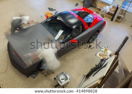NJ - August 2015: A Chevrolet Corvette is getting a vinyl wrap put on to change the look of the car.