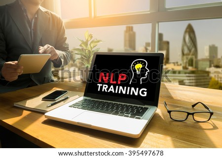 NLP TRAINING CONCEPT Thoughtful male person looking to the digital tablet screen, laptop screen,Silhouette and filter sun