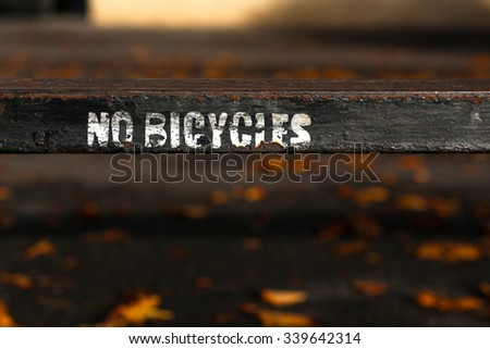 No bicycles white letters painted sign on old black rusty metal fence in Oxford, UK. - stock photo