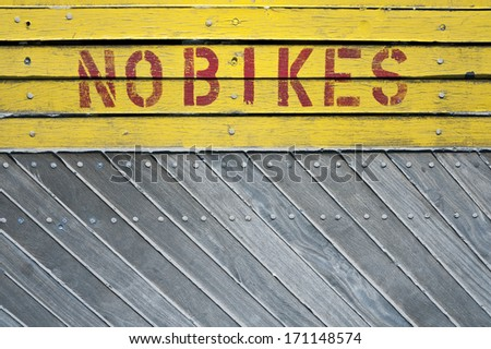 No bike sign on a wooden background