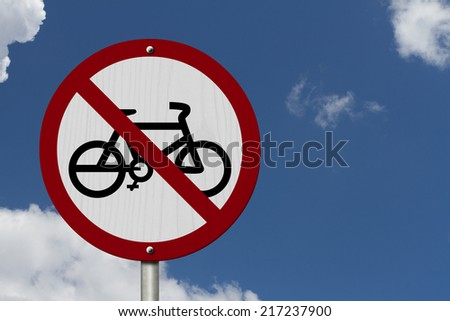 No Bikes Allowed Sign, An red road sign with bike icon and not symbol with blue sky background - stock photo