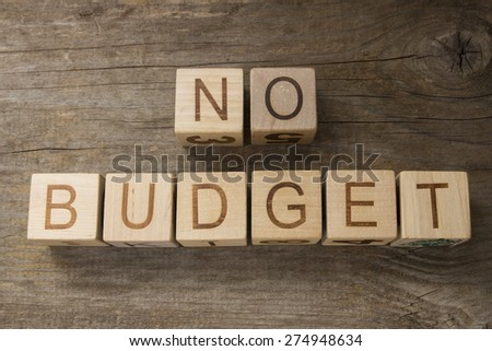 NO BUDGET text on a wooden background - stock photo