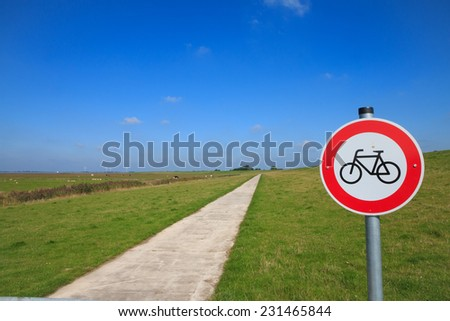 No cycling along dike at the Dollard in Ostfriesland, Northern Germany - stock photo