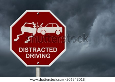 No Distracted Driving Sign, Red stop sign with words Distracted Driving and accident icon with stormy sky background - stock photo
