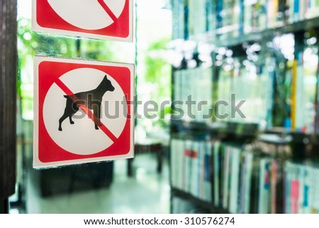 No dog allowed sign on the glass door outside coffee shop - stock photo