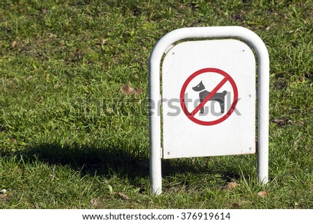 No dogs allowed sign in park - stock photo