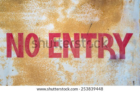 No Entry Sign on a rusted grunge signboard - stock photo