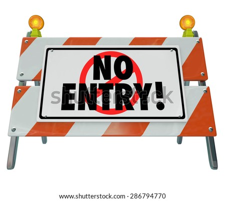 No Entry words on a road construction barrier, barricade or warning sign blocking your way or access to a forbidden area - stock photo