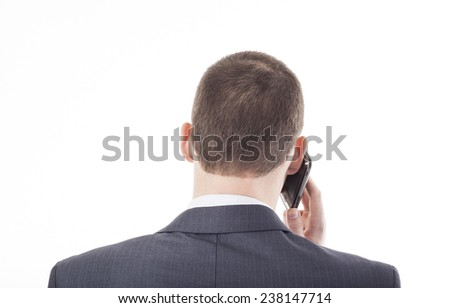 No face businessman Unrecognizable young adult person business man talking on black cell mobile phone isolated on white background Accurate strictly short male hair style - stock photo