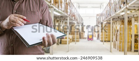 No face Unrecognizable person Businessman holding white texture empty list of paper and red pen Business man wearing stripped brown shirt Storekeeper signing document on clipboard - stock photo