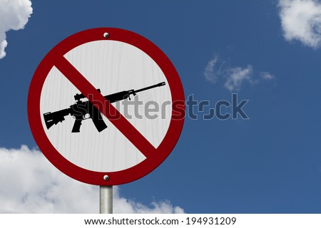 No Firearms Allowed Sign, An red road sign with handgun icon and not symbol with blue sky background