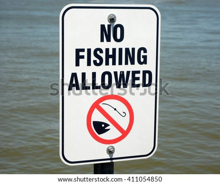 No fishing allowed sign against blue water background - stock photo