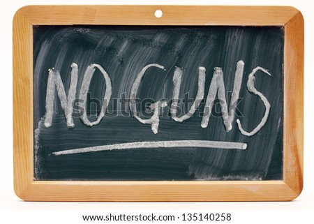 No guns message written on a blackboard - stock photo