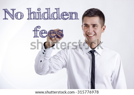 No hidden fees - Young smiling businessman writing on transparent surface - stock photo