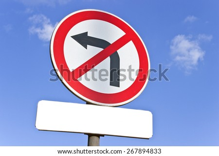 No left turn traffic sign over blue sky