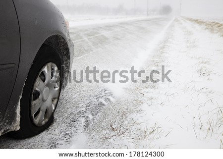 No luck today - flat tire during blizzard. - stock photo