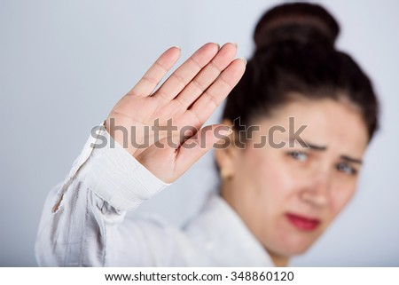 No More Concept,Stop Gesture.Portrait of a young woman with raised hand making No more gesture.No more Unhealthy food,No more smoking,Alcohol. - stock photo