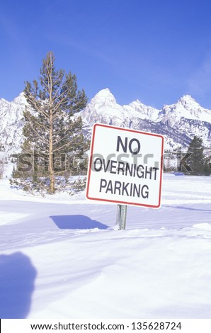 No overnight parking sign in a snow field - stock photo