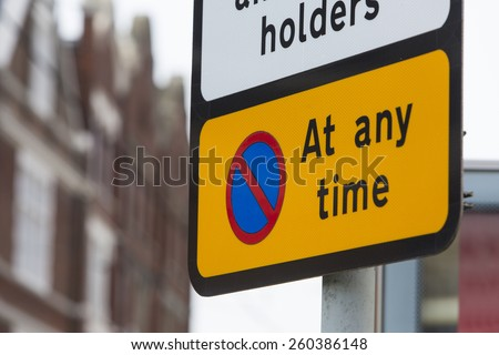 No parking at any time sign on a street during the day - stock photo