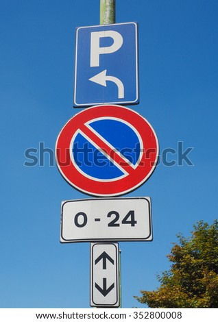 No parking here, cars parking on the left traffic sign over the blue sky