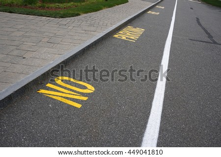 No parking lane with text sign on the street surface