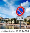 no parking road sign by Temo river in Bosa - stock photo