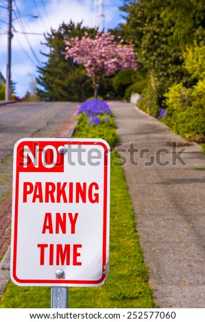 No parking sign in the street during spring sunny day - stock photo