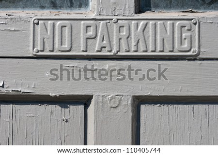 no parking sign on doors - stock photo