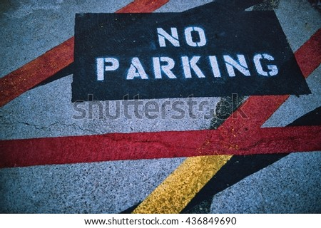 No parking sign painted on asphalt - stock photo