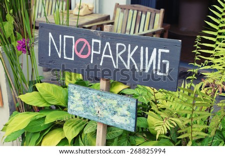 no parking wooden board sign - stock photo