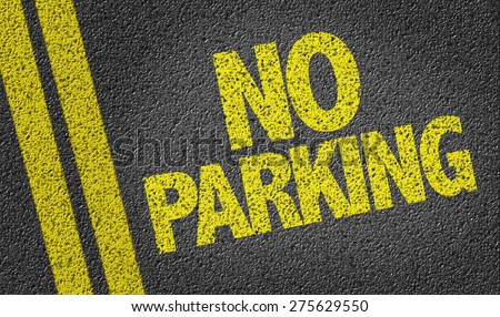 No Parking written on the road - stock photo