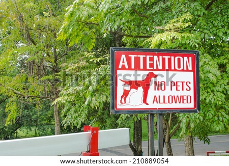 No pets allowed sign on gate in the park - stock photo