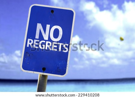 No Regrets sign with a beach on background - stock photo