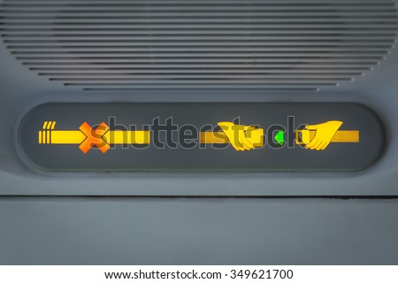 No Smoking and Fasten Seat belt Sign in the airplane - stock photo