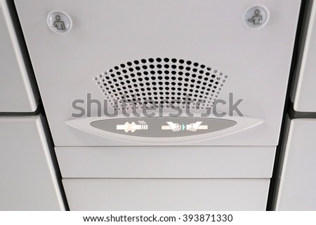 No Smoking and Fasten Seat belt Sign Inside an Airplane  - stock photo