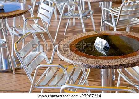 no smoking area in outdoor cafe on stern of cruise liner - stock photo