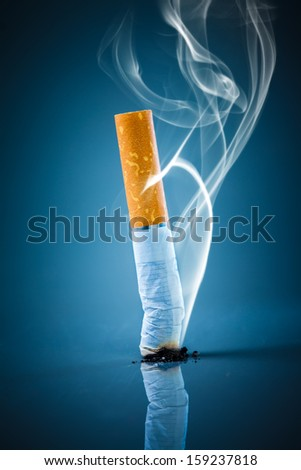 No smoking. Cigarette butt on a blue background. - stock photo