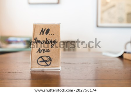 No Smoking Sign hand paint in coffee shop,Vintage tone - stock photo