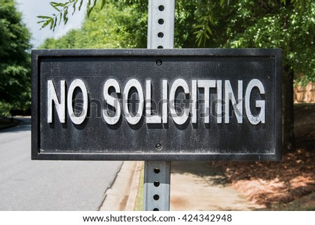 No Soliciting Sign in suburban neighborhood - stock photo