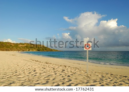 No swimming on sandy beach of tropical resort