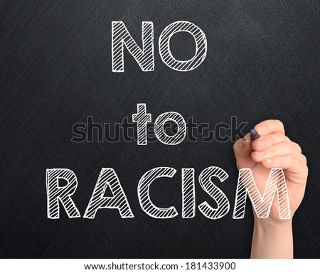 No to racism handwritten on blackboard - stock photo