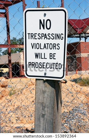 No trespassing sign on construction site - stock photo